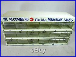 Vintage AC Guide, GM AC-Delco miniature lamps, light bulb shop parts cabinet